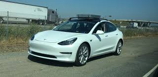 tesla model 3 tesla model 3 spotted testing with roof racks electrek