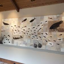 a source for quality fossil fish tiles for interior design in your call today to order your custom artistic fossil mural