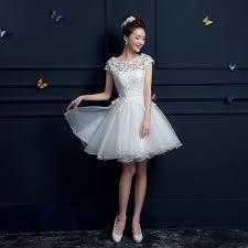 white lace dress with sleeves knee length cap sleeve lace dress below knee ivo hoogveld