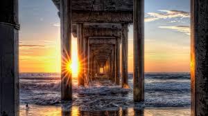 beaches underneath bright beautiful sunshine piering rays sunrise