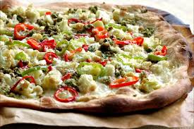 calabrian cuisine pizza with roasted cauliflower calabrian chiles and green olive