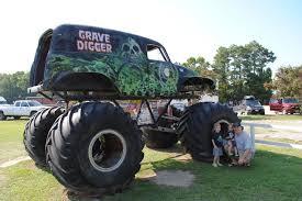 monster truck show involves truck crushing smaller