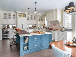 puritan off white cabinets in maple magnolia with a blue kitchen