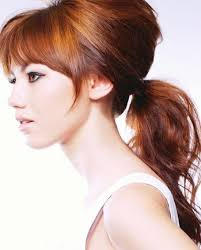 layer hair with ponytail at crown bumped ponytail the bump adds a little bit of edginess to an