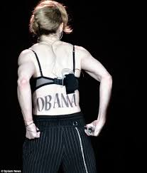 madonna backs obama with a huge temporary tattoo of his name