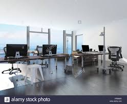 modern waterfront office overlooking the sea with several computer