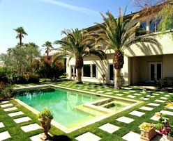 spectacular coral stone pool deck with palm tree landscaping ideas