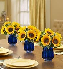 sunflower centerpieces sunflower centerpieces in cobalt vases sunflowers
