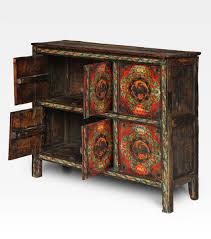 credenza tibetana credenza tibetana dipinta con fenici legno di pino cod 0007