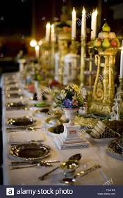 dining table and candelabra with floral arrangements and tableware