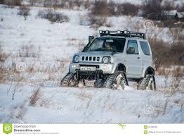 the car rides on tracks in the winter editorial stock photo image