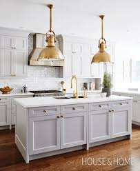 light gray kitchen cabinets with marble countertops grey gold the balance of warm with cool