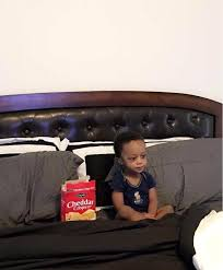 Sitting Meme - a kid sitting with his cheddar crisps pics