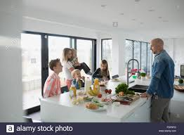 eating kitchen island family eating around kitchen island stock photo royalty free