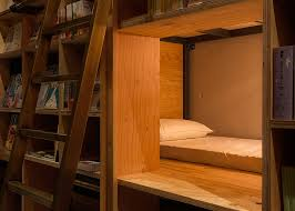Beds With Bookshelves Bookstore Themed Tokyo Hotel Has 1 700 Books And Sleeping Shelves