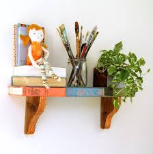 Upcycle Old Books - remodelaholic how to repurpose old books into a wall shelf