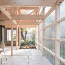 timber framed home by yoshichika takagi has attic bedroom and