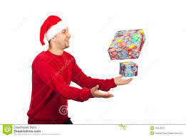 happy man trying to catch christmas gifts stock photo image