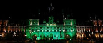 buildings light up in green in support of climate accord