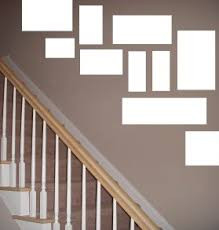 vancouver interior designers how to hang art on a staircase wall