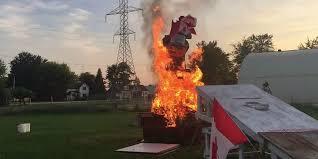 rowdy canadians jump a go cart through a flaming backyard bonfire