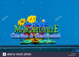 margaritaville cartoon neon sign on roof of jimmy buffett u0027s margaritaville casino and