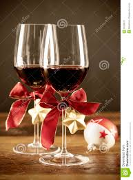 wine glass christmas ornaments two glasses of wine with christmas ornaments stock photos