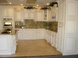 antiqued white kitchen cabinets