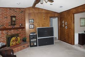 decoration awesome paint wood paneling with brick fireplace and