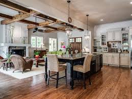 rustic great room with stone fireplace u0026 french doors in