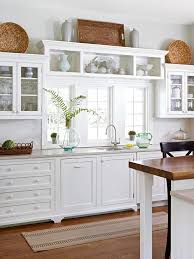 what to put on top of kitchen cabinets for decoration update your kitchen on a budget decorating above kitchen