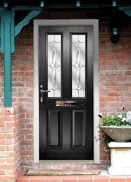 interior door handless in brown wooden door with stained glass