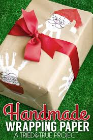 make your own wrapping paper santa handprint handmade wrapping paper tried true