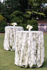 wedding inspiration reception tables with pattern linens inside