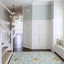House Ceiling Tall Wainscoting Helps Accentuate The High Ceilings In This