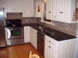 appealing uba tuba granite countertop with white cabinets 9
