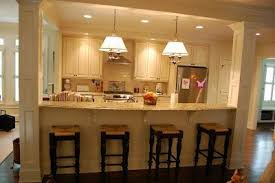 kitchen island wall half wall turned counter seating wit seating reversed to the