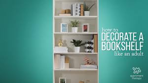 how to decorate a bookshelf how to decorate your bookcase like a pro apartment therapy