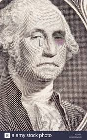 closeup of a george washington on the one dollar bill george has