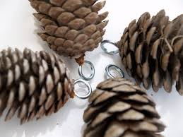 how to hang pine cones to insert an eyelet drill a tiny hole