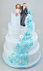 tiffany blue floral cascade wedding cake with a handmade bride and