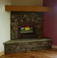 stone facing accent wall corner fireplace living room for the home fireplace living rooms small living rooms and fireplace design