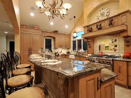 a two tiered kitchen island with granite countertops provides bar