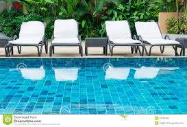 High Beach Chairs Swimming Pool With White Beach Chairs Royalty Free Stock Images