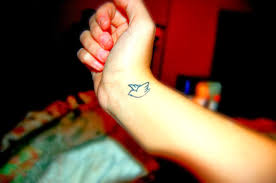 collection of 25 small wings tattoos on wrist