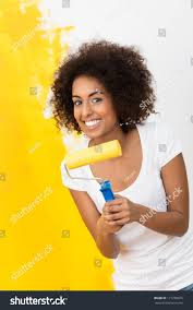 playful african american woman painting her stock photo 171278825