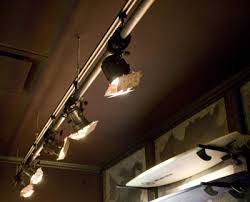custom designed track lights created for hollister retail stores