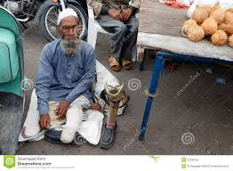 Seeking In India Indian Sick And Handicapped Beggar Seeking Help On A Busy Road