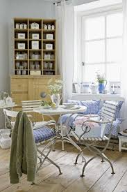 romantic dining room with classic dining chairs and round white
