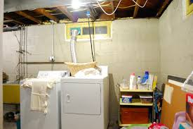 before makeover small basement laundry room design with rack for